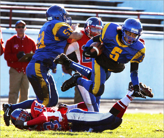 KYLE JIMENEZ-FOX, East Boston High School senior running back, leaping over a South Boston defender during his team's 12-6 win to capture the Boston North League title, Nov. 24, 2011 -- 'You know this game, you've got to play hard or you go home. I was just playing my hardest. Anything it takes, I was willing to do to win. I just expect anything in the city championships. I got hit earlier and it was kind of a cheap shot, so I just decided to get up and run harder next time. As the play is just going, I don't really know what I'm thinking. I just do it as it's coming, deciding when to jump or when to just keep going. I'ma senior. This has been a long journey for me. This rivalry has been going on since 1901. It feels big to me. This is a big win. I can talk about this for the rest of my life, that we beat Southie in 2011 and are the city champs.'