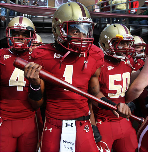 Boston College wide receiver COLIN LARMOND JR. carries a baseball bat onto the field during pregame introductions at Alumni Stadium, Nov. 12, 2011 -- 'Well, it all started in the Friday night meeting with the players. The captains speak to the team and then the other players, if they have something to say, can talk. [Offensive lineman] Bryan Davis was telling us that before he left to go to school, he gave his mom a baseball bat and said, 'If anyone tries to break into the house, use the baseball bat and swing.' He related it to how on Saturday we're playing a game-the last home game and senior day against the [North Carolina State] Wolfpack. He said, 'You know the wolves are going to come into our house and attack in packs and what were we going to do to keep them out?' He had that baseball bat and he said, 'Seniors, you better go out swinging,' and he gave me the bat. So I just ran out on the field with the bat and we did come out swinging, so I guess that's our new little bat now. I want to say it's a Louisville Slugger ... Oh, and that Mama's Boy on the towel, that's because I grew up with my mom[in Morristown, N.J.], who was a single mother, so I' m not afraid to say I am a mama's boy.'
