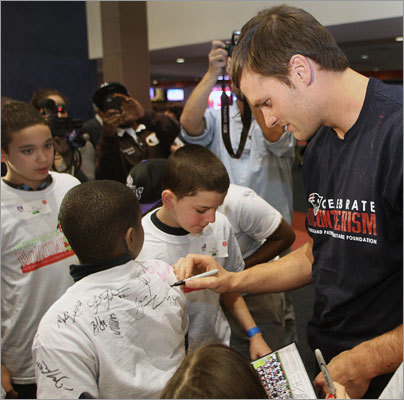 Dec. 13 in Foxborough Brady signed plenty of autographs for the children.