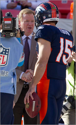 Tebow shook hands with NFL commissioner Roger Goodell.
