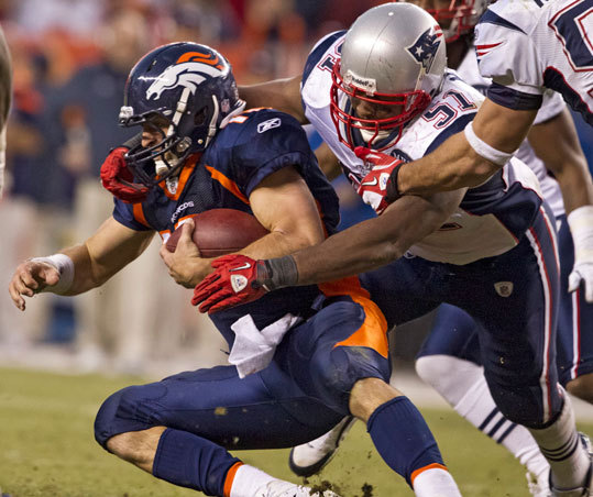 Patriots Jerod Mayo stops Broncos quarterback Tim Tebow for a short gain during fourth quarter action.