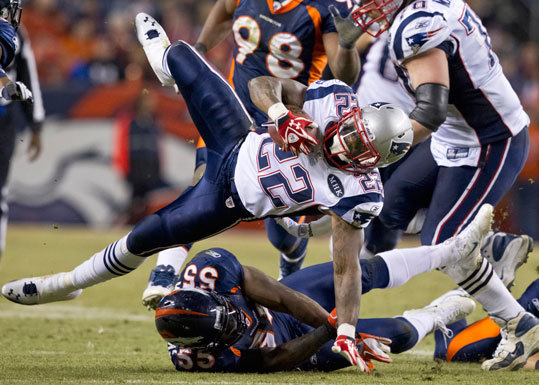 Patriots running back Stevan Ridley is upended by the Broncos D.J. Williams during fourth quarter action.