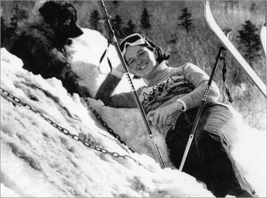 Laney O'Brien, 21, of Falmouth, took a break on March 9, 1977 with her dog, Leo, at Wildcat Mountain in Pinkham Notch, N.H.