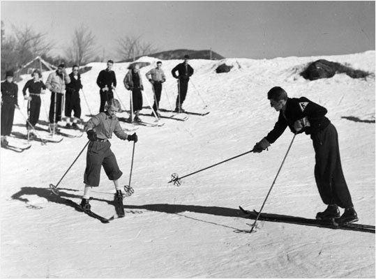 An Eastern Slopes ski school instructor showed skiers the proper method of doing the 'stemboggan' at Cannon Mountain in this photo taken Dec. 15, 1938.