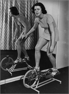 More indoor skiing: A woman took a skiing/biking/treadmill-like device in 1939.