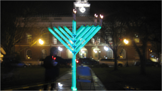 On Wednesday night, Needham's Chabad Jewish Center welcomed residents to its annual menorah lighting on the Needham Town Common. The Chabad Center menorah has a different theme each year. This year's is a large, glow-in-the-dark menorah. Click through the gallery to see past Needham menorahs.