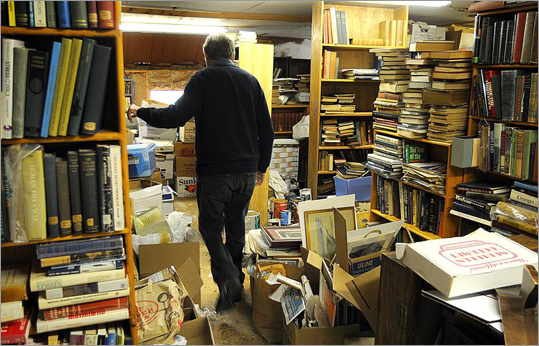 While their stock of 35,000 used volumes ranges across topics, the Haineses have around 6,000 volumes of Quaker books, which are mostly stored in the barn's upper level. David Haines, who also teaches chemistry at Wellesley College, walked through the attic storage area filled with Quaker books and papers.