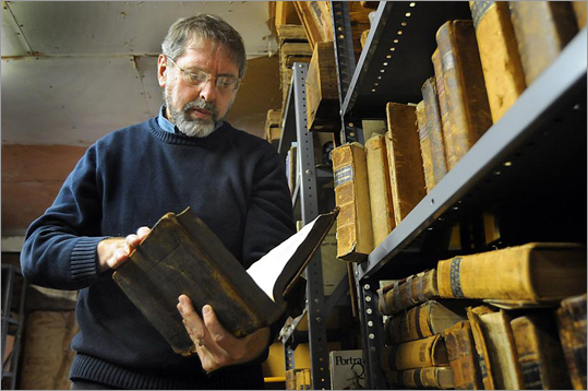 Some of the volumes piled or shelved upstairs — and some cherished volumes, papers or handbills in the Haineses' house — are the only copies in existence. Several are more than 300 years old. David flipped through the pages of a Quaker volume from around 1700.