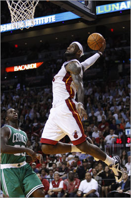 LeBron James soared past Brandon Bass for a dunk in the first half.
