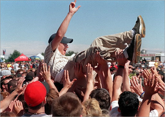 2000 A fan was carried by other fans during a concert of ' Suicide Machines' in Vans Warped Tour 2000 at Suffolk Downs.