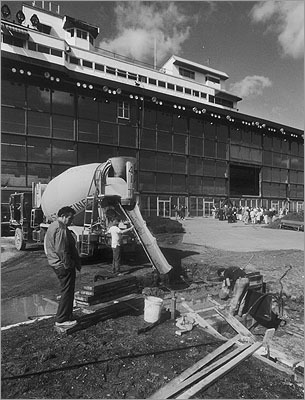 1991 Workmen poured cement in the winners circle in 1991.