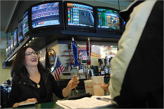 2006 Bartender Daralyn Francione, of Revere, bantered with a customer in a bar at Suffolk Downs on Dec. 29. The tracks faced closure at the end of the year, unless Legislature extended the simulcasting rights.