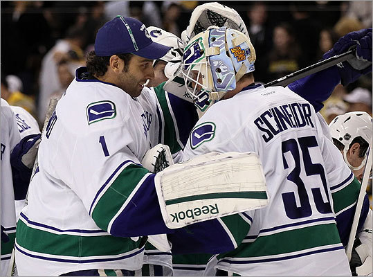Roberto Luongo congratulated Cory Schneider after the Canucks win over the Bruins.