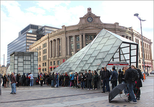 Shortly after 2 p.m., the line of participants had stretched out near the entrance to the Red Line entrance in front of South Station.