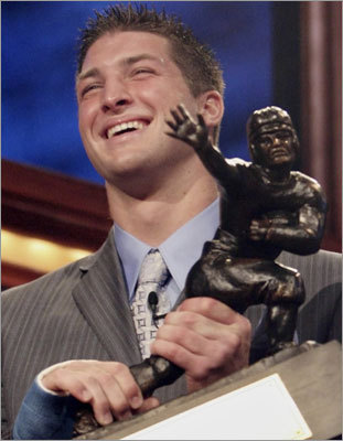 He's a phenom As is the case with most things concerning Tebow, saying he 'can't play' isn't exactly true. Tebow was named Florida's high school player of the year twice, and he was a highly-recruited All-American his senior season. At Florida, Tebow won two BCS national championships, winning the Heisman Trophy (left) in 2007. He finished his college career as the SEC's all-time leader in completion percentage (67.1 percent) and total touchdowns responsible for (145).