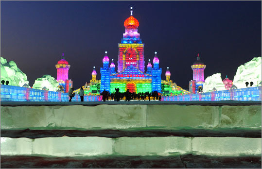 Tourists visited ice sculptures on the night before the opening ceremony.