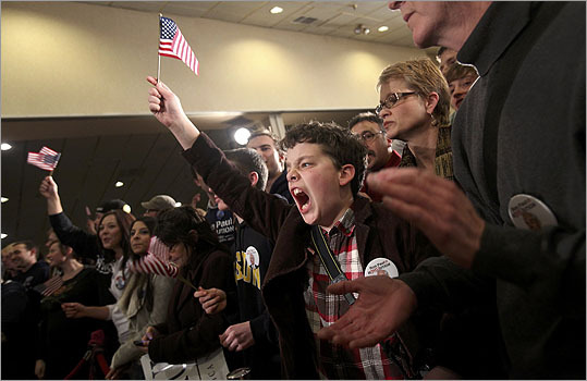 A young supporter of Paul celebrates at Paul's New Hampshire primary night rally in Manchester