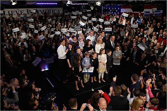 Mitt Romney stood on stage with his family during his primary night rally Jan. 10 at Southern New Hampshire University in Manchester, N.H. Romney finished first.