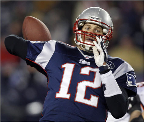 Patriots quarterback Tom Brady reached back to pass during the second half.