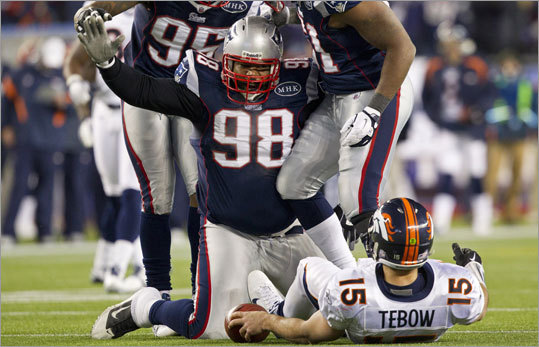 Gerard Warren and the Patriots took down Tim Tebow and the Broncos Saturday, 45-10.
