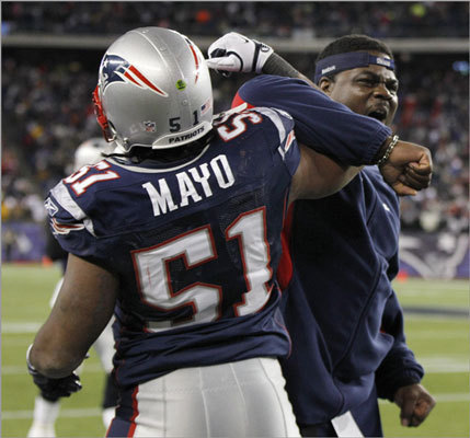 Patriots defensive line coach Pepper Johnson, right, celebrated with middle linebacker Jerod Mayo during the second half.