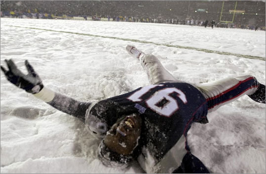 Patriots defensive end Bobby Hamilton celebrated by making a snow angel.