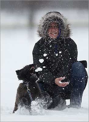 Trish Kapur, of Boston, played with her five- year old Cairn Terrier named Kona Bear during the snow fall.