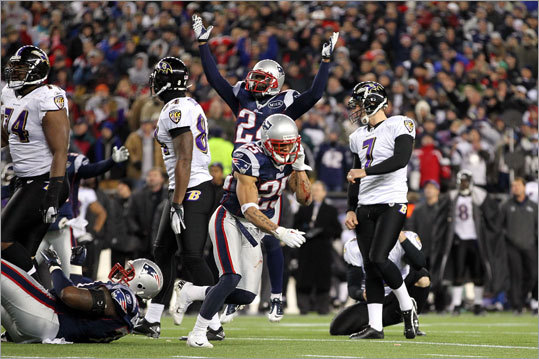 The Patriots celebrated after Ravens kicker Billy Cundiff missed a field goal in the final seconds of the AFC Championship that could have tied the score.