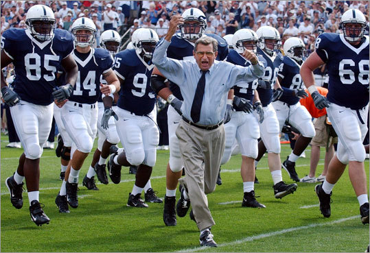 Penn State coach Joe Paterno leads his team onto the field before an NCAA college football game against Akron in State College, Pa.