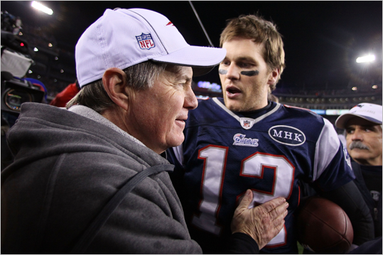 Tom Brady celebrated with Bill Belichick after the Patriots defeated the Ravens, 23-20, at Gillette Stadium.