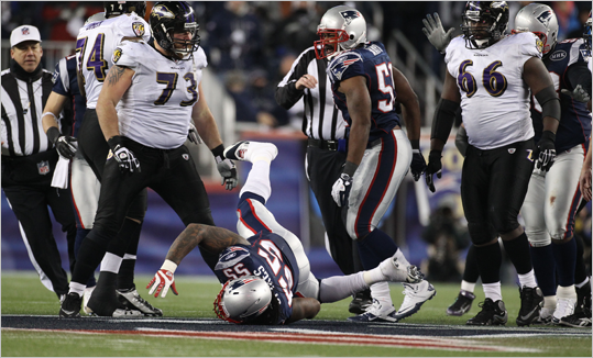 Ravens guard Marshal Yanda pushed Patriots linebacker Brandon Spikes in the third quarter.