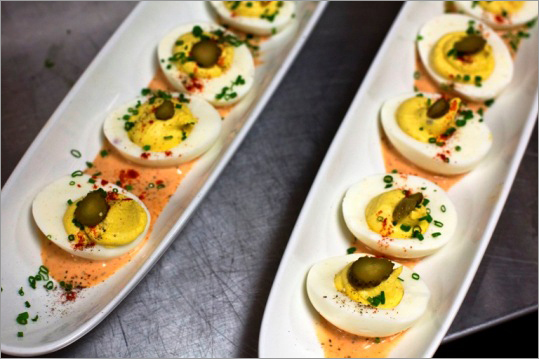 One of Saloon's appetizers: The deviled eggs with pistachios, cornichons, and spicy Russian dressing.