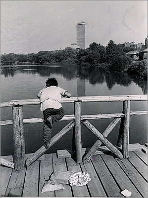 1965 A boy fishing in the pond.