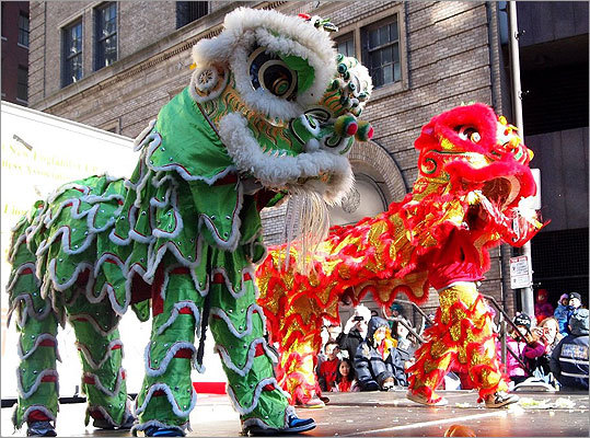 A lion from the Wong Family Benevolent Association sent a head of lettuce flying.