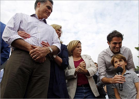 Mitt Romney watches as his grandson Parker said 'hola' at a campaign stop in Hialeah, Fla., on Jan. 29. With them are Romney's wife Ann, US Representative Ileana Ros-Lehtinen (center) and Romney's son Craig.