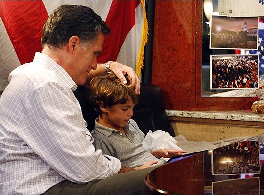 Mitt Romney sat with his grandson Parker, 5, on his campaign bus en route to a rally in Pompano Beach, Fla., on Jan. 29.