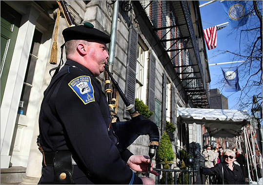 Boston police Officer Joe Cheevers, with the Boston Police Gaelic Column, played the bagpipes outside the Parkman House during the public viewing.