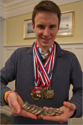 McDowell has 17 medals, and he has attracted the attention of college recruiters. He hopes to jump 7 feet someday, and before he leaves Hingham, he wants to beat the school's outdoor record of 6 feet 8 inches. McDowell shows his 17 track and field medals, acquired in his three years on the Hingham High School track team.