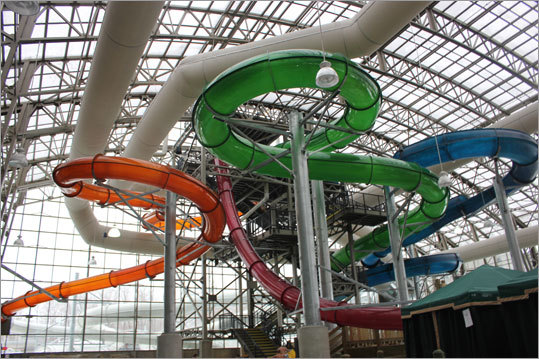 Three of the water slides - two of which utilize blow-up tubes, twist and turn both indoors and outside (not exposed), each going pitch dark for a portion before splashing into a pool. The red slide is called, 'La Chute,' and features a 60-foot drop before throttling the rider into a dramatic twist.