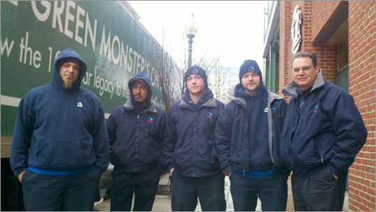The crew poses for a photo before loading up the truck at Fenway Park Saturday morning. From left to right: Keith, Rolando, Bill, Mike and Kevin Carson, operations manager for New England Household Moving and Storage. 'I remember back in 1995 when it was just five guys loading a truck,' Carson said when talking about the transformation of Truck Day at Fenway. 'Then Dr. Charles [Steinberg] got here [in 2002] and everything changed.'