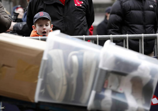 Josh Berman, 7, of Framingham, watches as equipment is loaded into the trailer on Truck Day.