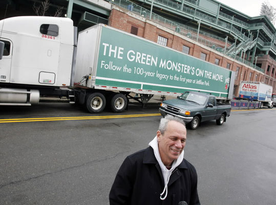 Larry Lucchino speaks with reporters outside Fenway Park on Saturday.