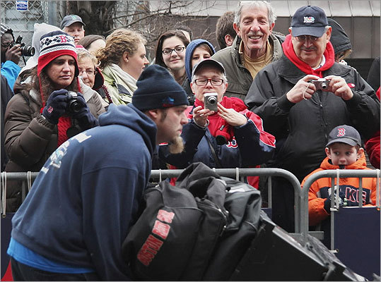 Fans turned out in the cold and watched as Red Sox equipment was moved.