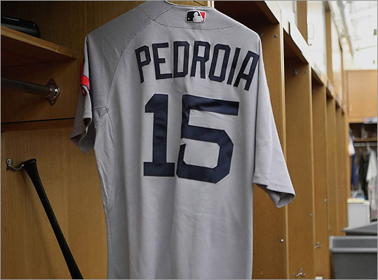 In the Sox locker room, Dustin Pedroia's jersey was ready to be packed up.