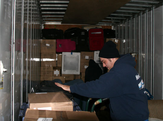 Before long, the truck was full of boxes, suitcases, and other assorted items needed for spring training.