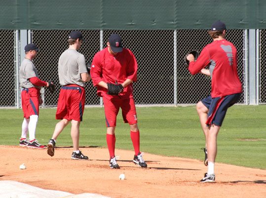 Red Sox pitchers, including Andre Miller (front) toed the rubber as they prepared for the season before the official start of spring training.