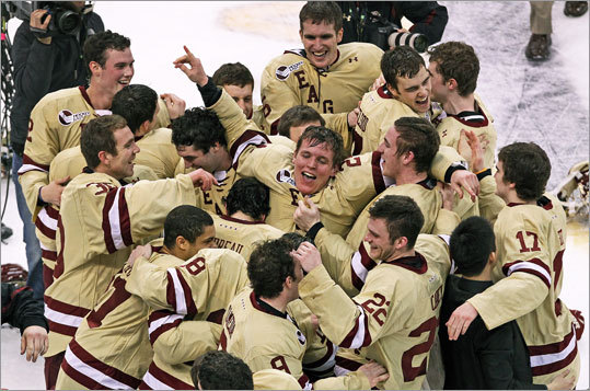 Boston College's Bill Arnold (center) is ecstatic after he delivered the game-winning goal with 6.4 seconds left in the first overtime of the Beanpot final. BC defeated Boston University, 3-2.