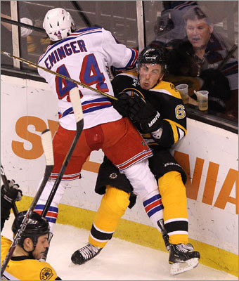 The Bruins' Brad Marchand took a heavy hit from Rangers defenseman Steve Eminger in the first period.