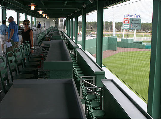 It's a little different from Fenway Park's left field wall because fans can sit inside the Green Monster at JetBlue Park in addition to taking in the view from on top of the wall.