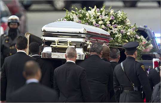 Pall-bearers carried the casket of pop singer Whitney Houston to a hearse following her funeral service.
